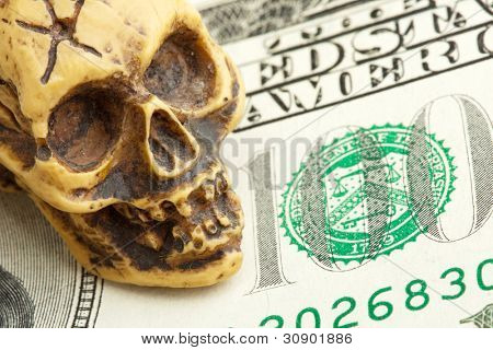 Bankruptcy concept. Human skull on money banknote