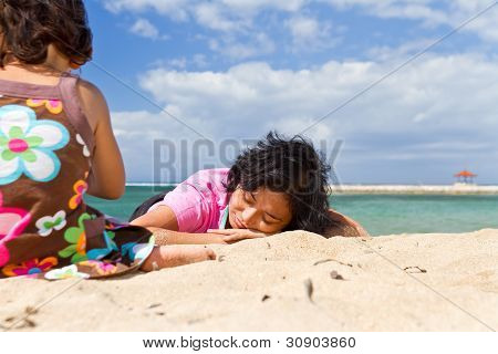 Asian Mother Relaxing At The Beach