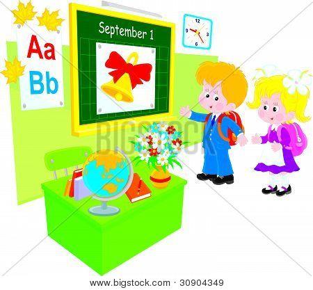Schoolboy and schoolgirl in a class