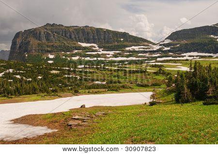 Mountain Pass In Summer Snow