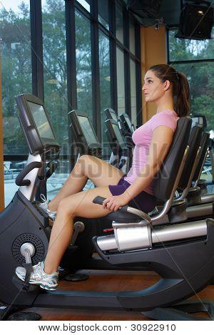 Beautiful Female Athlete On A Cycling Machine (3)