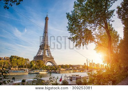 poster of Sunset View Of Eiffel Tower And Seine River In Paris, France. Architecture And Landmarks Of Paris. P