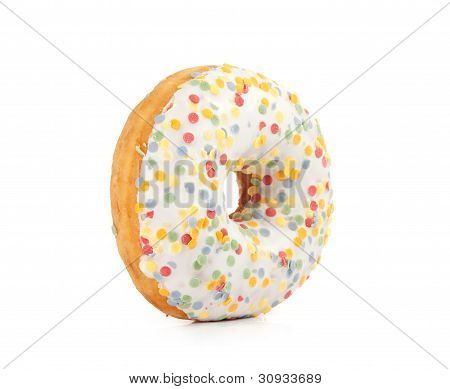 Doughnut Covered In Sprinkles Isolated On White Background