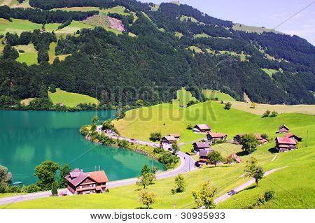 Beautiful Switzerland landscape with houses, lake and mountain