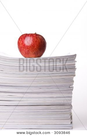 Apple In A Stack Of Books