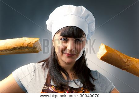 woman cook with broken french bread