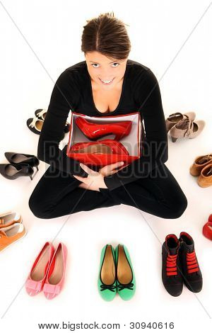 A picture of a young woman with a new pair of heels over white background
