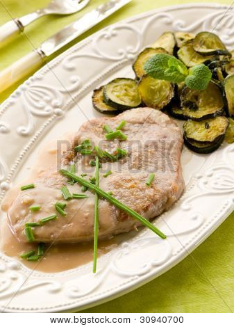 escalope with white wine sauce and sauteed zucchinis