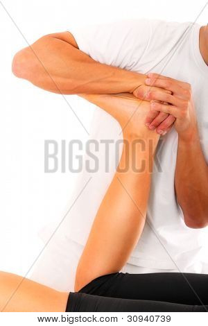 A picture of a physio therapist trying to fix the leg over white background