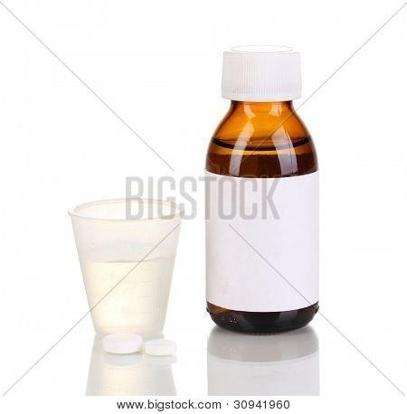 Medical bottle and jigger isolated on white