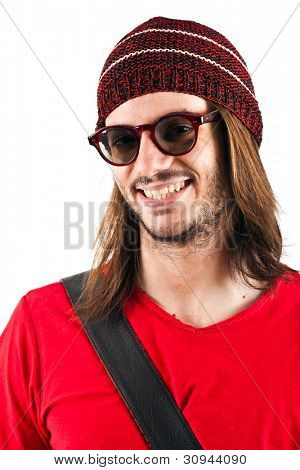 Portrait of a young handsome guy smiling isolated on white