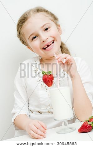 Strawberry time - lovely girl with milk and strawberry cocktail