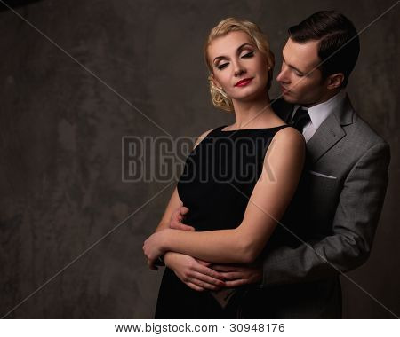 Retro couple on grey background.