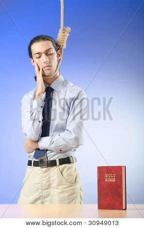 Businessman reading bible before hanging himself