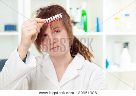 Girl student holding a microtube