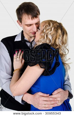 Portrait Of A Kissing Young Couple