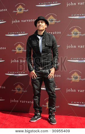 LOS ANGELES - MAR 11:  Taboo of the Black Eyed Peas arrives at the 9th Annual John Varvatos Stuart House Benefit at the John Varvatos Store on March 11, 2012 in West Hollywood, CA