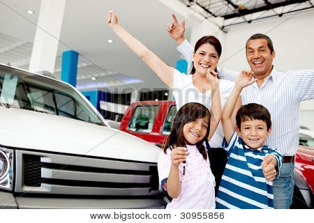 Happy family with arms up celebrating having a new car