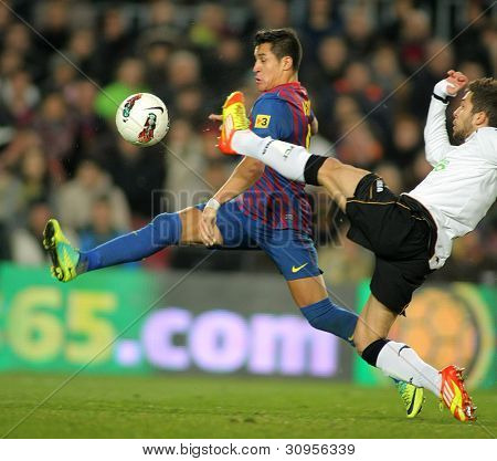 BARCELONA - FEB, 19: Alexis Sanchez(L) of FC Barcelona vies with Jordi Alba(R) of Valencia CF during the Spanish league match at the Camp Nou stadium on February 19, 2012 in Barcelona, Spain