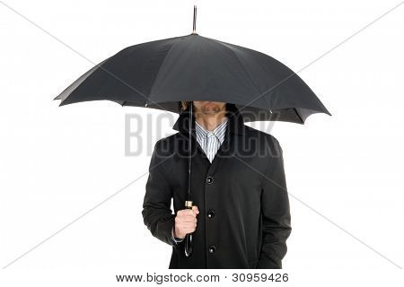 elegant business man in a raincoat standing under an umbrella.