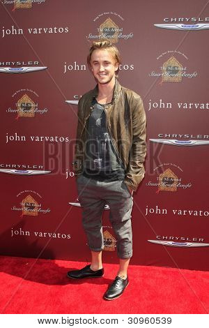 WEST HOLLYWOOD, CA - MARCH 11 Tom Felton at the 9th Annual John Varvatos Stuart House Benefit on March 11, 2012 in West Hollywood, California
