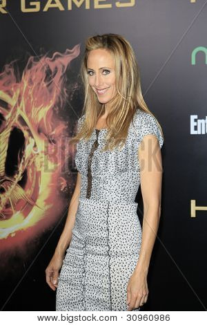 LOS ANGELES, CA - MARCH 12: Kim Raver at the premiere of Lionsgate's 'The Hunger Games' at Nokia Theater L.A. Live on March 12, 2012 in Los Angeles, California