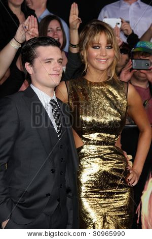 "LOS ANGELES - MAR 12:  Josh Hutcherson; Jennifer Lawrence arrives at the ""Hunger Games"" Premiere at the Nokia Theater at LA Live on March 12, 2012 in Los Angeles, CA"