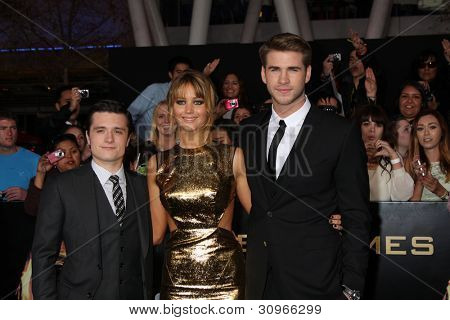 LOS ANGELES - MAR 12:  Josh Hutcherson; Jennifer Lawrence; Liam Hemsworth arrives at the