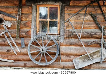 Facade of an ancient wooden log hut