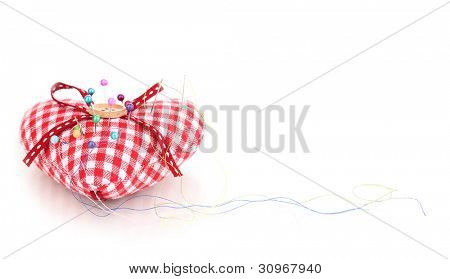 Colored pinheads in pin-cushion isolated on white