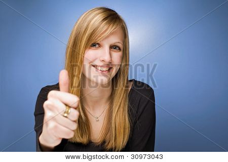 Young Blond Beauty Showing Thumbs Up.
