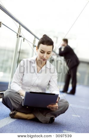 Atractive Woman With Notebook