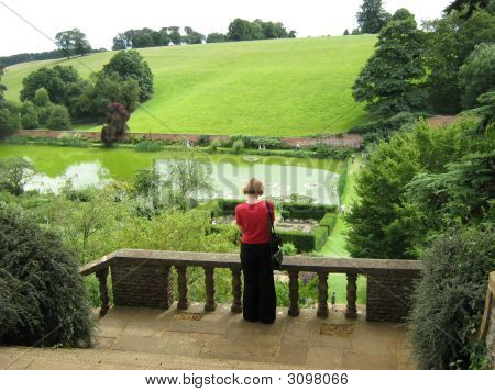 Woman/ Visitor Standing Alone Looking At Landscape