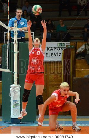 KAPOSVAR, HUNGARY - FEBRUARY 3: Karmen Kovacs (red 12) in action at the Hungarian Championship volleyball game Kaposvar (red) vs Miskolc (green), February 3, 2012 in Kaposvar, Hungary
