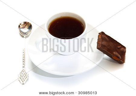 Cup Of Coffee With A Spoon And A Piece Of Chocolate