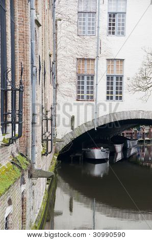Boats And Facade From A Brugge Channel
