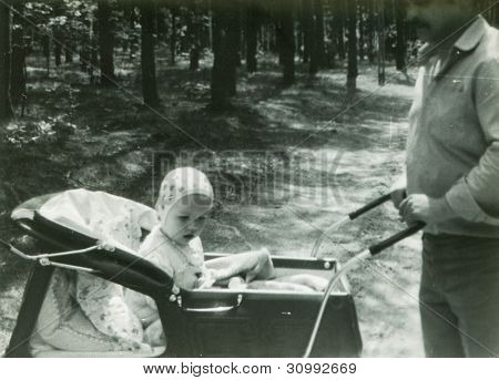 Vintage photo of young father with baby son (early eighties)