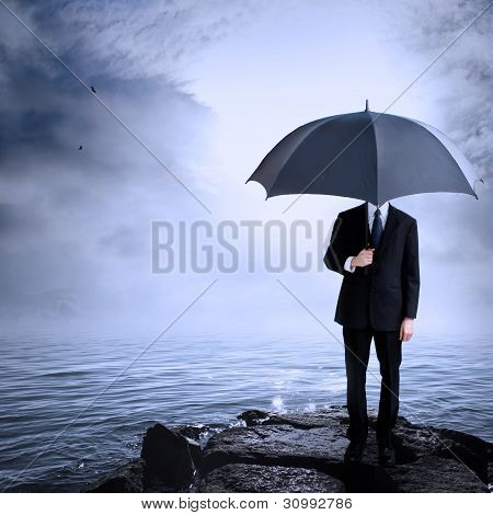 Man Holding Umbrella at the Coast