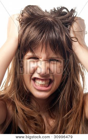 Angry and frustrated teenage girl grinding with teeth