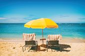 Beach holiday lounging chairs under sun umbrella vacation background. Summer tropical travel destina poster
