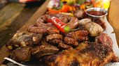 Mixed Grilled Meat Platter. Assorted Delicious Grilled Meat With Vegetable. Mixed Grilled Meat With  poster