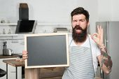 Providing Training Course. Bearded Cook With Ok Sign Holding Blackboard In Training School. Hipster  poster