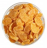 stock photo of cereal bowl  - Corn flakes heap in a glass bowl - JPG