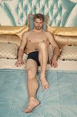 Rococo And Baroque Interior. Luxury Relax Resort. Man Attractive Muscular Body Relax On King Size Be poster