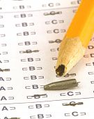 foto of self assessment  - a broken pencil sitting on a test paper - JPG