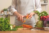 The Chef Cuts Fresh Carrots For Salad. The Concept Of Losing Healthy And Wholesome Food, Detox, Vega poster