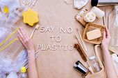 Reusable Recyclable Sustainable Wooden Toothbrush Compare To Plastic One Isolated On Brown Craft Fab poster