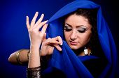 foto of yashmak  - Beautiful young woman in color Arabian clothes - JPG