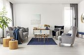 Grey And Navy Blue Living Room Interior With Comfortable Sofa And Armchairs poster