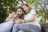 Two Girls Surprise Social Media Unexpected Youth Millennial Friendship Media Concept Addiction To Ne poster